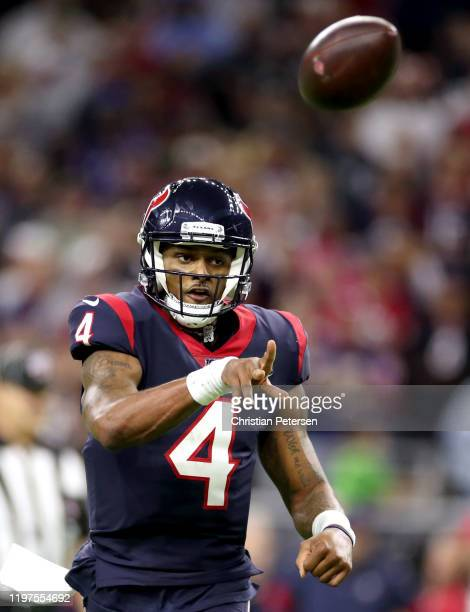 Deshaun Watson of the Houston Texans throws a touchdown pass against the Buffalo Bills during the fourth quarter of the AFC Wild Card Playoff game at...