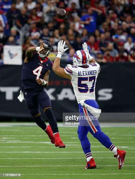 Deshaun Watson of the Houston Texans throws over Lorenzo Alexander of the Buffalo Bills during the AFC Wild Card Playoff game at NRG Stadium on...