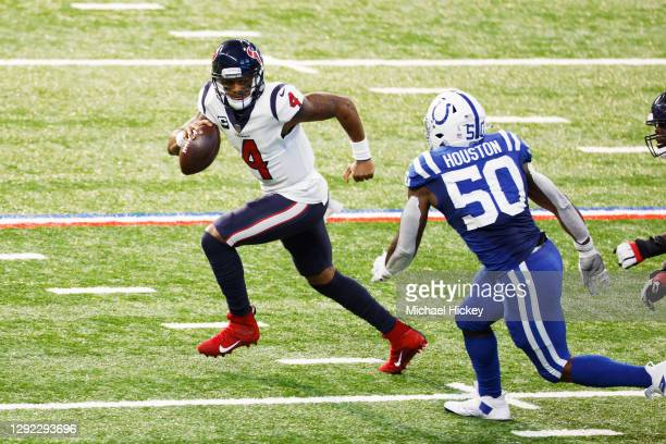 Deshaun Watson of the Houston Texans tries to avoid the tackle of Justin Houston of the Indianapolis Colts in the first half at Lucas Oil Stadium on...
