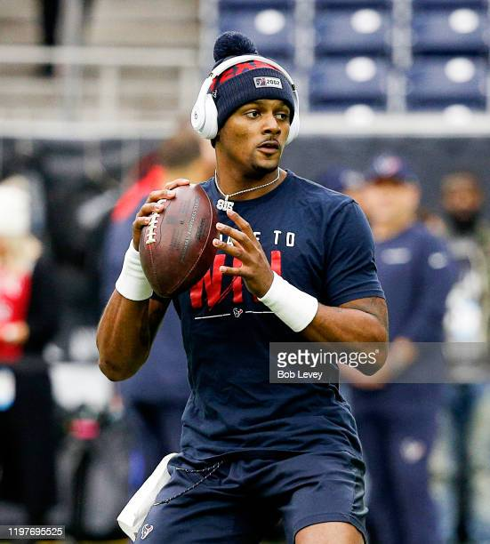 Deshaun Watson of the Houston Texans warms up before the AFC Wild Card Playoff game between the Buffalo Bills and Houston Texans at NRG Stadium on...