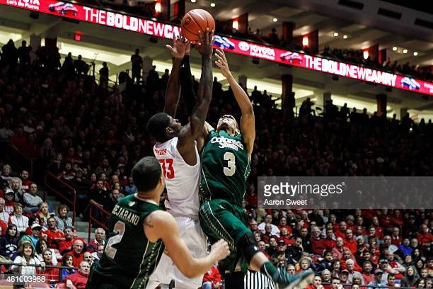 Deshawn Delaney of the New Mexico Lobos fights for a rebound against Gian Clavell of the Colorado State Rams during their game at The WisePies Arena...
