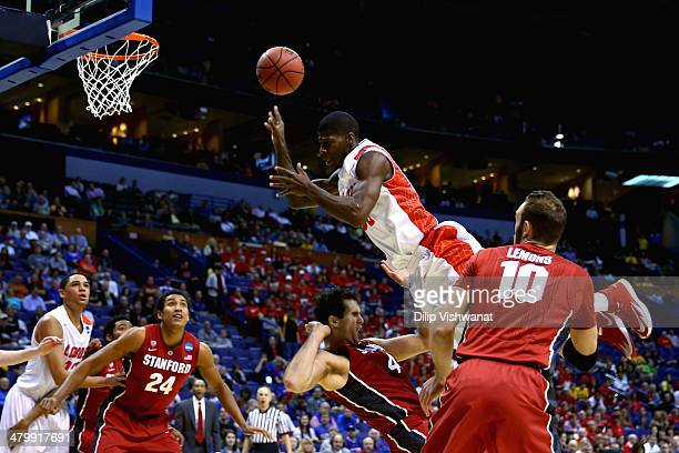 Deshawn Delaney of the New Mexico Lobos gets fouled in the first half by Stefan Nastic of the Stanford Cardinal during the second round of the 2014...