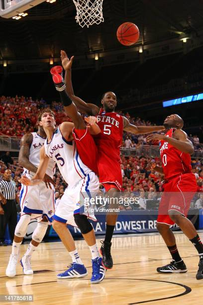 DeShawn Painter and C.J. Leslie of the North Carolina State Wolfpack attempt to control the ball in the first half against Jeff Withey of the Kansas...