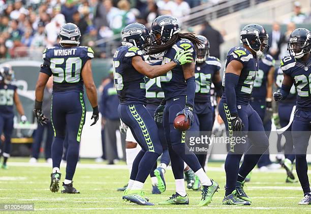 DeShawn Shead celebrates with Richard Sherman of the Seattle Seahawks against the New York Jets at MetLife Stadium on October 2 2016 in East...