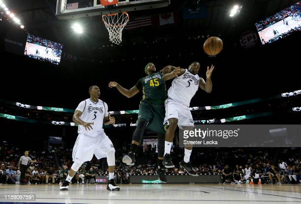 DeShawn Stevenson of Ball Hogs and Frank Robinson of Enemies compete for possession during week two of the BIG3 three on three basketball league at...