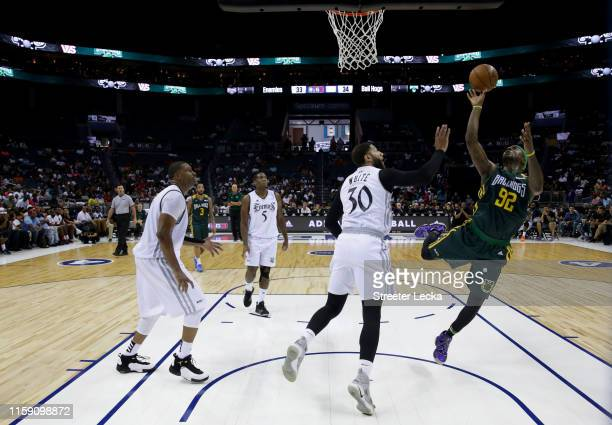 DeShawn Stevenson of Ball Hogs shoots over Royce White of Enemies during week two of the BIG3 three on three basketball league at Spectrum Center on...