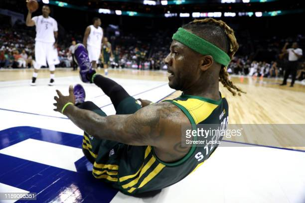 DeShawn Stevenson of Ball Hogs slides on the floor against Enemies during week two of the BIG3 three on three basketball league at Spectrum Center on...
