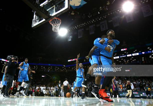 Deshawn Stevenson of Power celebrates with teammates after defeating TriState during week one of the BIG3 three on three basketball league at...