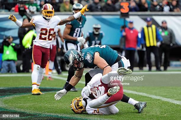 Deshazor Everett of the Washington Redskins catches an interception as Zach Ertz of the Philadelphia Eagles can't make the stop and Bashaud Breeland...