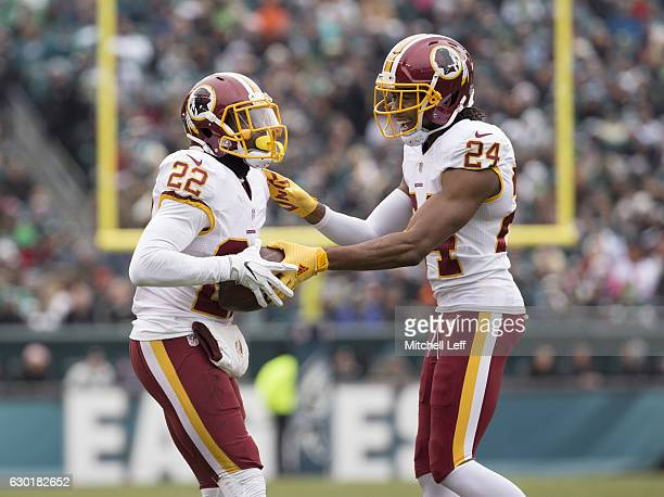 Deshazor Everett of the Washington Redskins celebrates with Josh Norman after his interception in the first quarter at Lincoln Financial Field on...