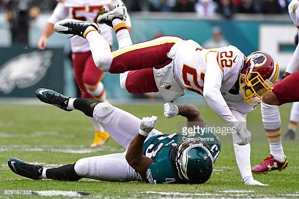 Deshazor Everett of the Washington Redskins lays out Darren Sproles of the Philadelphia Eagles on a kickoff return during the fourth quarter at...