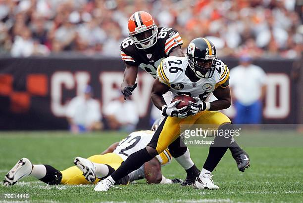 Deshea Townsend of the Pittsburgh Steelers intercepts a ball intended for Tim Carter of the Cleveland Browns during their season opening game at...