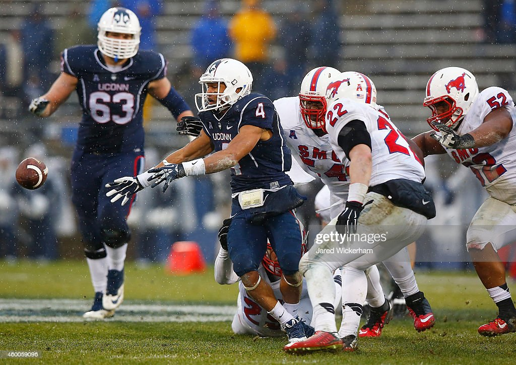 Deshon Foxx #4 of the Connecticut Huskies fumbles the ball in the second half against the SMU Mustangs during the game at Rentschler Field on December 6, 2014 in East Hartford, Connecticut.