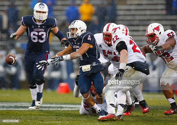 Deshon Foxx of the Connecticut Huskies fumbles the ball in the second half against the SMU Mustangs during the game at Rentschler Field on December 6...