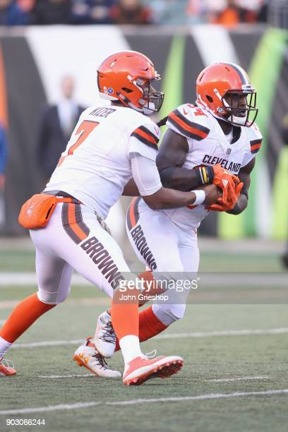 DeShone Kizer of the Cleveland Browns hands off to teammate Isaiah Crowell during their game against the Cincinnati Bengals at Paul Brown Stadium on...