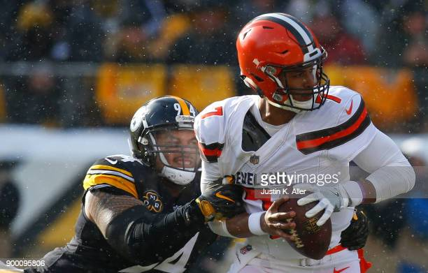 DeShone Kizer of the Cleveland Browns is sacked by Tyson Alualu of the Pittsburgh Steelers in the first quarter during the game at Heinz Field on...