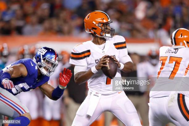 DeShone Kizer of the Cleveland Browns looks to pass while under pressure from Olivier Vernon of the New York Giants in the first half of a preseason...
