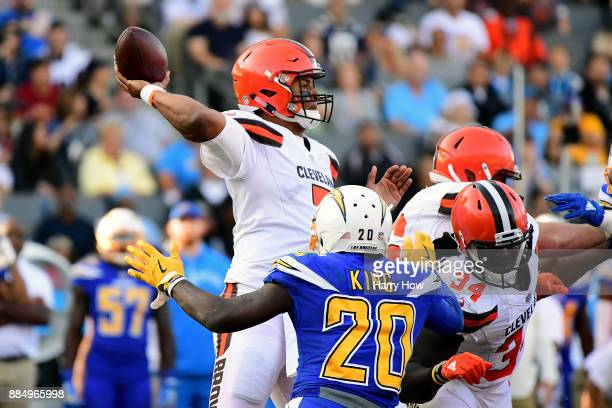 DeShone Kizer of the Cleveland Browns passes in the pocket as he is rushed by Desmond King of the Los Angeles Chargers during the third quarter of...