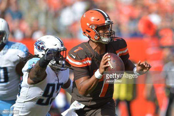 DeShone Kizer of the Cleveland Browns shakes off a sack attempt from DaQuan Jones of the Tennessee Titans in the second quarter at FirstEnergy...