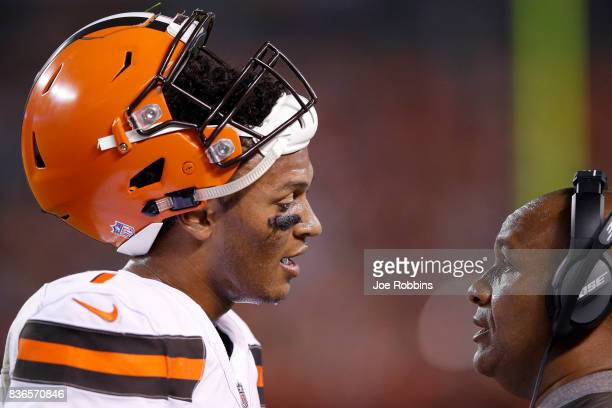 DeShone Kizer of the Cleveland Browns talks with head coach Hue Jackson in the second half of a preseason game against the New York Giants at...
