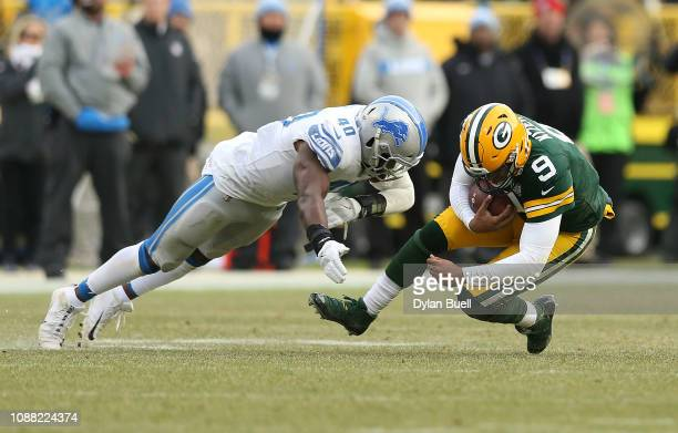 DeShone Kizer of the Green Bay Packers gets sacked by Jarrad Davis of the Detroit Lions during the second half of a game at Lambeau Field on December...