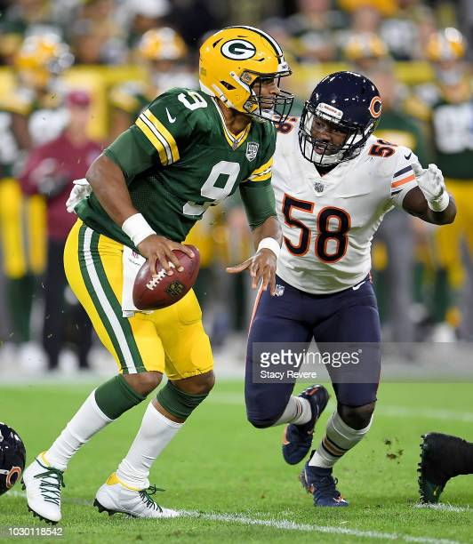 DeShone Kizer of the Green Bay Packers is sacked by Roquan Smith of the Chicago Bears during the second quarter of a game at Lambeau Field on...