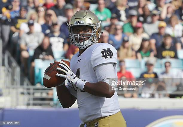 DeShone Kizer of the Notre Dame Fighting Irish attempts a pass during the game against the Navy Midshipmen at EverBank Field on November 5 2016 in...