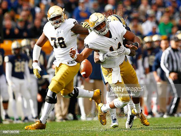 DeShone Kizer of the Notre Dame Fighting Irish fumbles the ball after being hit by KeiVarae Russell of the Pittsburgh Panthers in the first quarter...