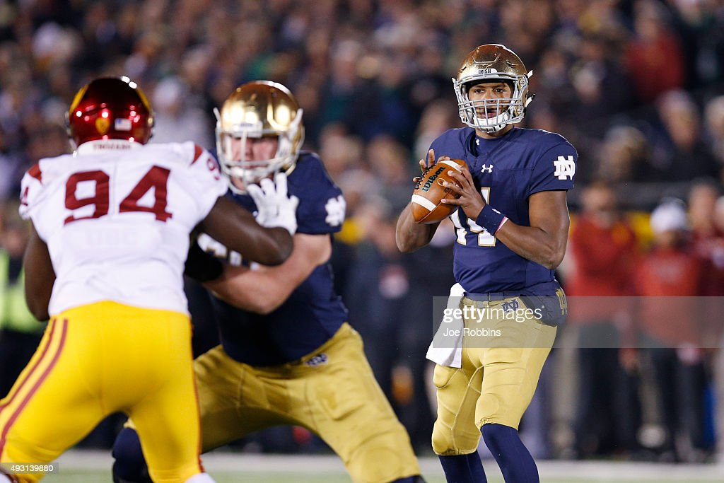 DeShone Kizer #14 of the Notre Dame Fighting Irish looks to pass against the USC Trojans in the first half of the game at Notre Dame Stadium on October 17, 2015 in South Bend, Indiana.