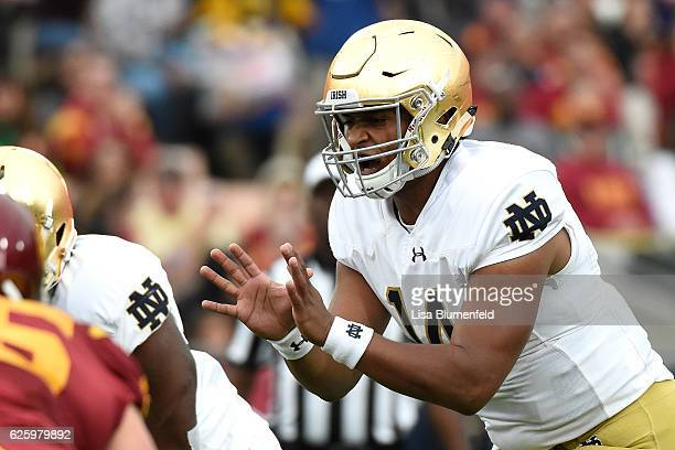 DeShone Kizer of the Notre Dame Fighting Irish prepares to snap the ball in the first quarter against the USC Trojans at Los Angeles Memorial...