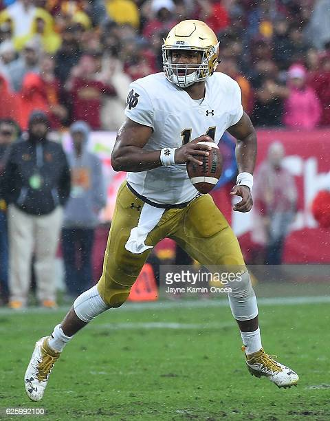 DeShone Kizer of the Notre Dame Fighting Irish sets to pass in the second quarter of the game against the USC Trojans at the Los Angeles Memorial...