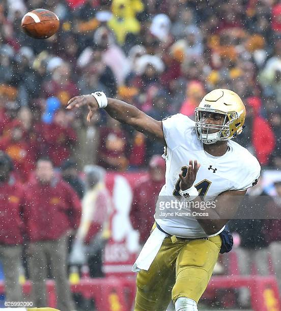 DeShone Kizer of the Notre Dame Fighting Irish throws a pass in the second quarter of the game against the USC Trojans at the Los Angeles Memorial...