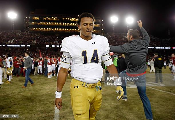 DeShone Kizer of the Notre Dame Fighting Irish walks off the field after they lost to the Stanford Cardinal on a lastsecond field goal at Stanford...