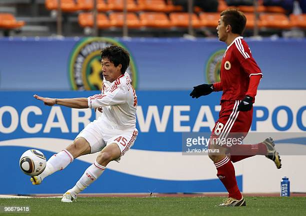 Deshuai Xu of Hong Kong and Linpeng Zhang of China compete for the ball during the East Asian Football Championship 2010 match between Hong Kong and...
