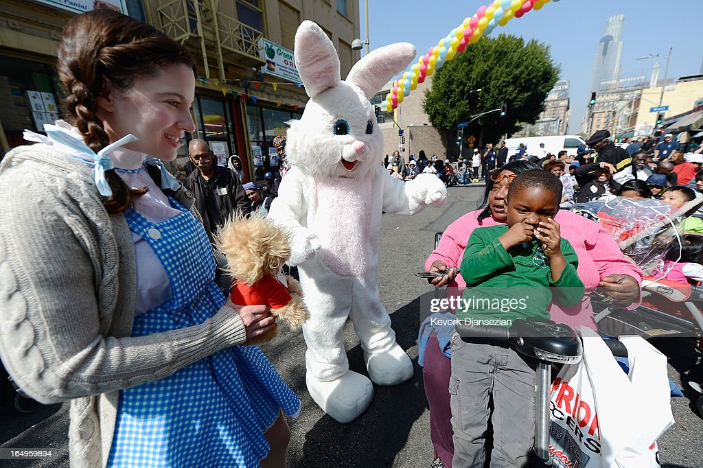 DeShun Gibson, 4, seated on the lap of his grandmother Birdie Bellinger, gets a visit from the Easter bunny as they wait for the start of Skid Row Easter event at the Los Angeles Mission on March 29, 2013 in Los Angeles, California. Volunteers, celebrities and nurses distributed more than 1000 Easter baskets to children and provided 3,500 hot meals, 2,000 pairs of shoes and and podiatric care to the homeless of Skid Row.
