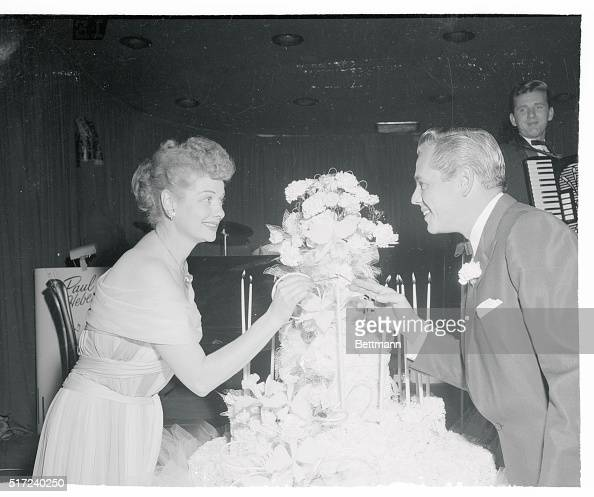 Lucille Ball And Desi Arnaz Lighting A Candle Pictures