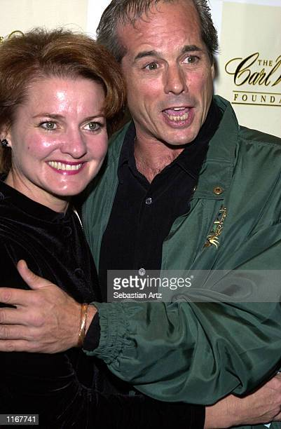 Desi Arnaz Jr and his wife Amy Bargiel arrive at the Carl Wilson benefit concert October 14 2001 at the El Rey Theatre in Los Angeles CA