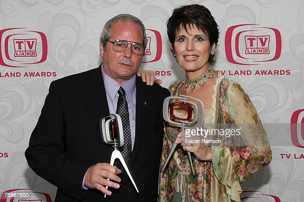 Desi Arnaz Jr and Lucie Arnaz pose with the Legacy of Laughter Award for their mother the late Lucille Ball backstage at the 5th Annual TV Land...