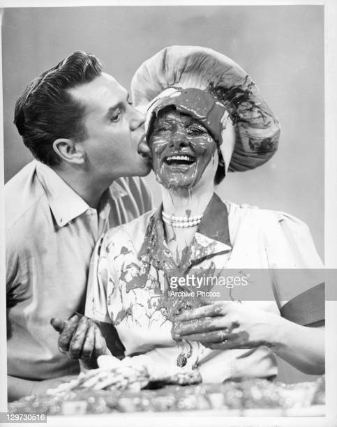 Desi Arnaz licking the face of his wife Lucille Ball in the television series 'I Love Lucy', 1951.
