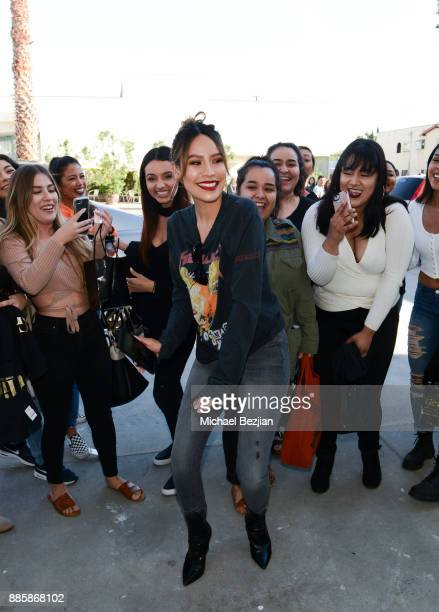 Desi Perkins and fans attend Impressions Vanity Melrose Grand Opening Gala on December 4 2017 in Los Angeles California