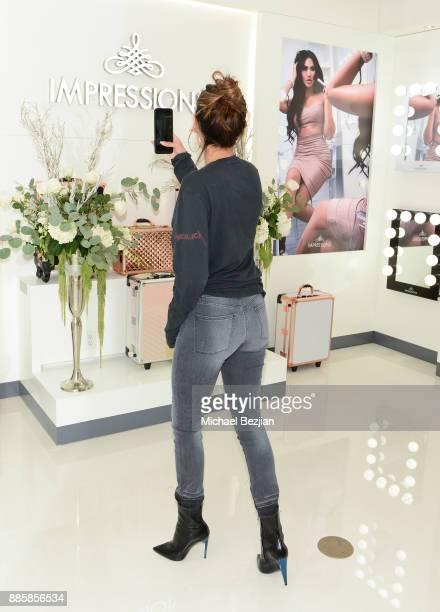 Desi Perkins attends Impressions Vanity Melrose Grand Opening Gala on December 4 2017 in Los Angeles California