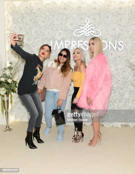 Desi Perkins Isabel Bedoya and Melly Sanchez pose with fan at Impressions Vanity Melrose Grand Opening Gala on December 4 2017 in Los Angeles...