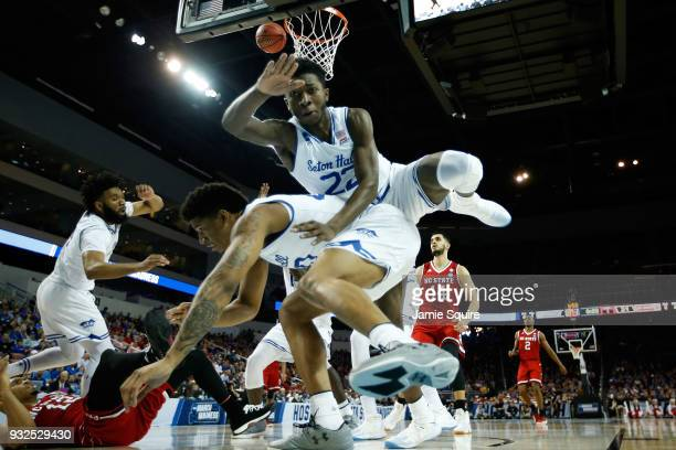 Desi Rodriguez and Sandro Mamukelashvili of the Seton Hall Pirates collide in the first half against the North Carolina State Wolfpack during the...