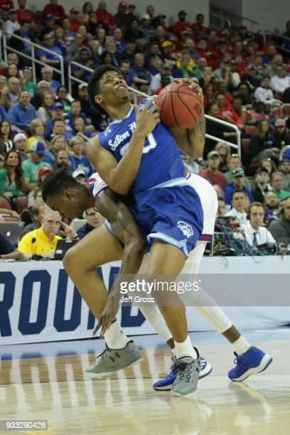 Desi Rodriguez of the Seton Hall Pirates fights to keep the ball against Lagerald Vick of the Kansas Jayhawks in the first half during the second...