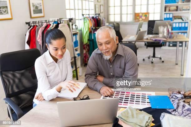 Desigenrs working in fashion studio