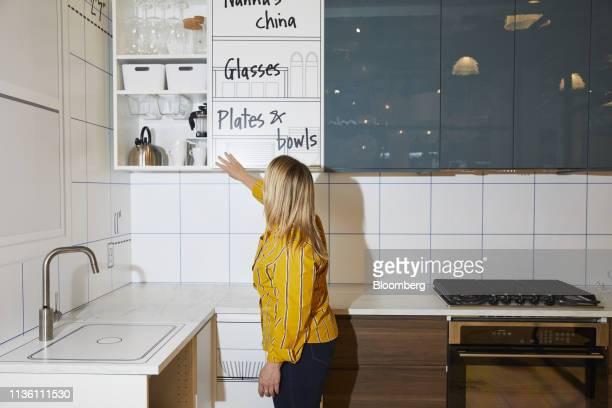 A design associate points to a storage cabinet in a kitchen display at the Ikea Planning Studio in New York US on Tuesday April 9 2019 This is the...