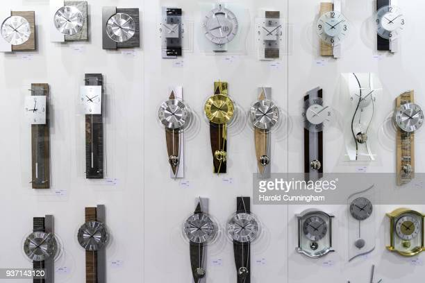 Design clocks are displayed at the BaselWolrd watch fair on March 23 2018 in Basel Switzerland The annual watch trade fair sees the very latest...