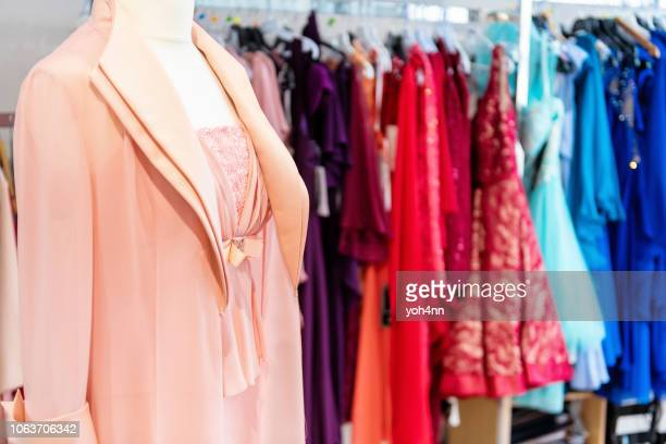 design clothing boutique - clothes rack stock pictures, royalty-free photos & images