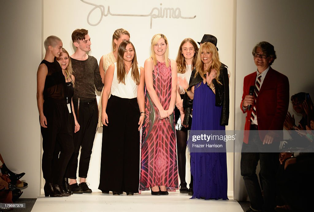 Design Contest finalists Hannah Soukup, Will Riddle, Morgan Selin, Carly Rosenbrook, Rachel Buske, Sylvia Bukowski, Bradley Mounce stand on the runway with Rachel Zoe, and Vice President of Marketing Buxton Midyette at the Supima Spring 2014 fashion show during Mercedes-Benz Fashion Week at The Studio at Lincoln Center on September 5, 2013 in New York City.