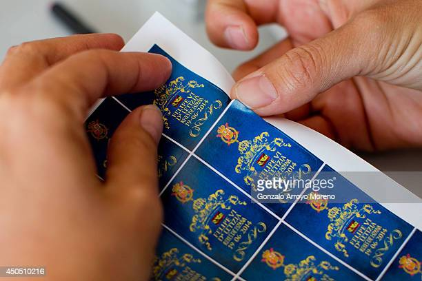 Design coordinator Carmen checks recently printed stamps of the Prince Felipe coronation at LK Merchandising Factory on June 12, 2014 in Colmenar...